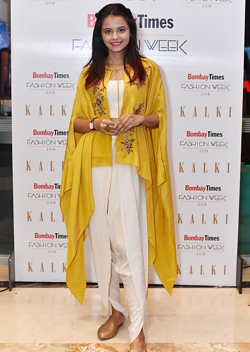f1cf4ea4fdb76 Off white dhoti pant and crop top paired with embroidered mustard kaftan  only on KalkiMore Detail