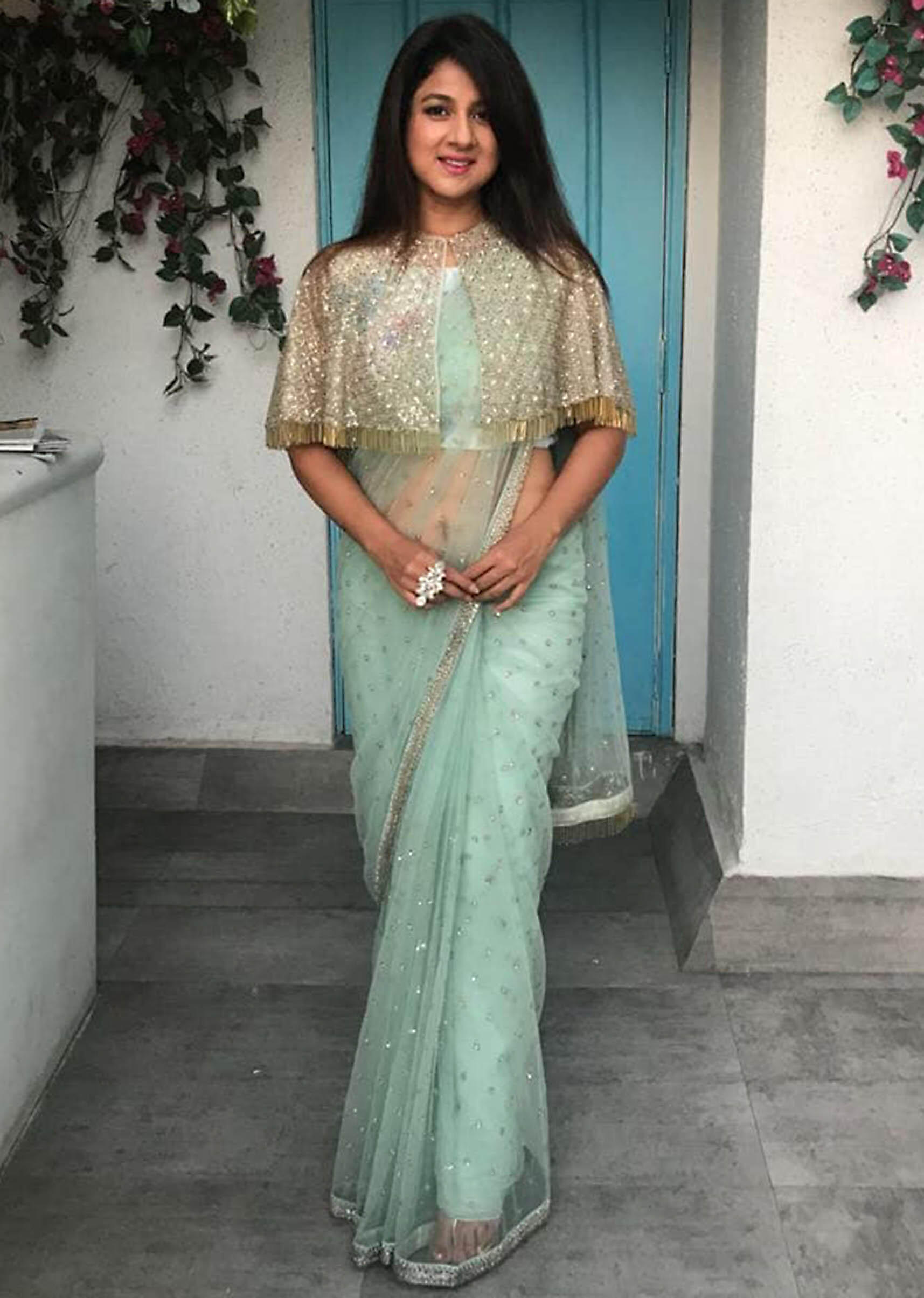 c697026430394d Mint Green Net Saree with Cape Net Blouse Featuring Sequins and Tassels  only on Kalki