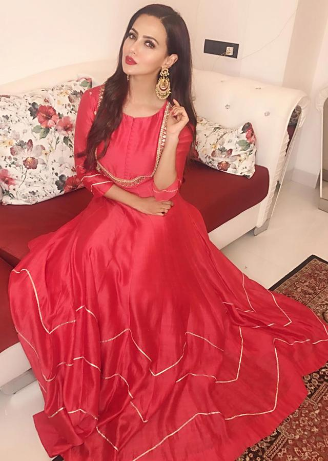 Sana Khan in tomato red modern and traditional gown only on Kalki