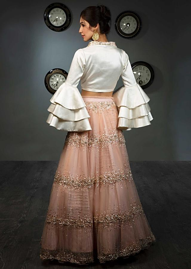 White Blouse In Satin With Layered Frill Sleeves Paired With Peach Net Skirt In Moti And Sequins Embroidery Online - Kalki Fashion