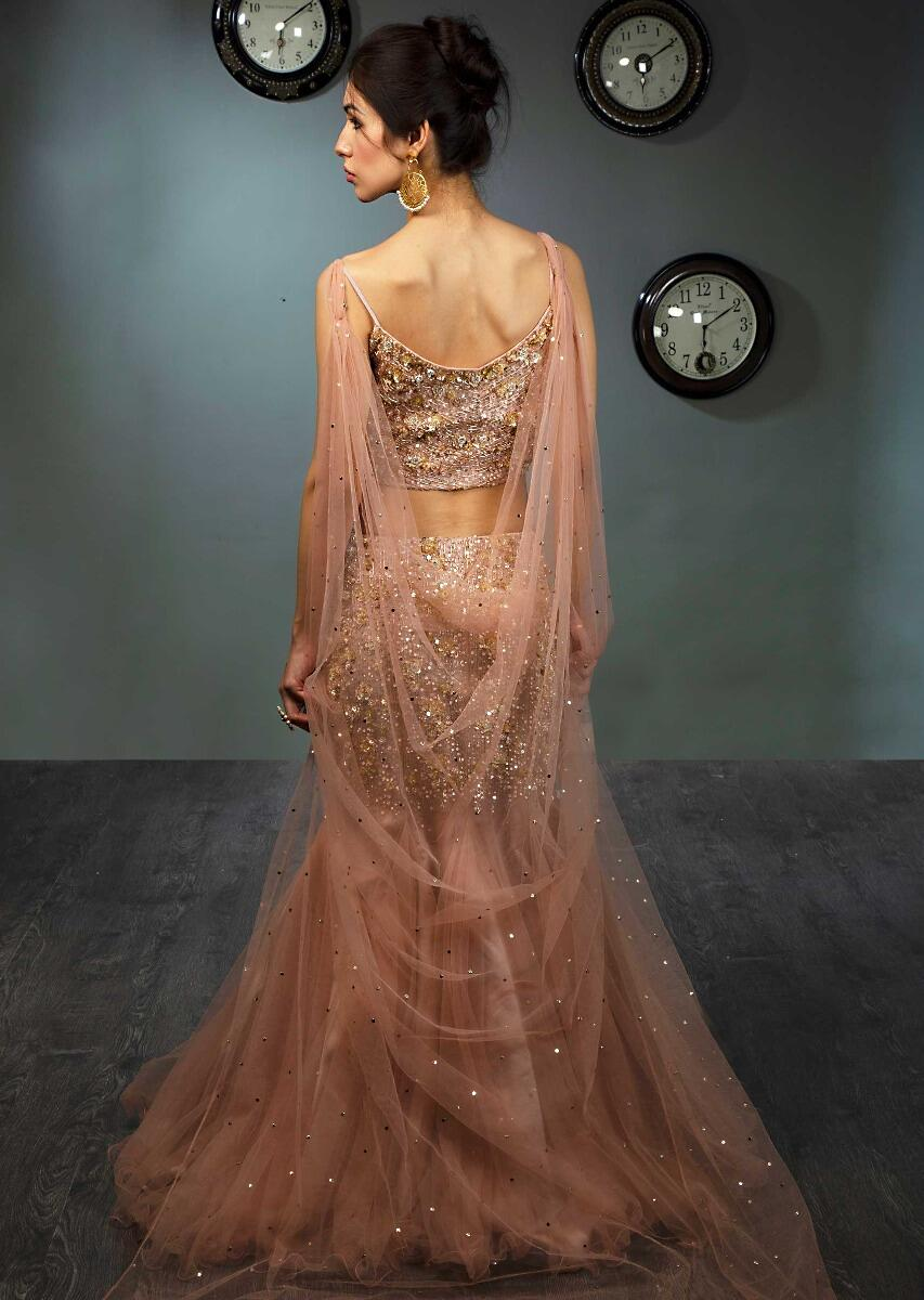1941a13f86 Fish cut embroidered net skirt paired with strap crop top in sequins  embroidered net cape only on Kalki
