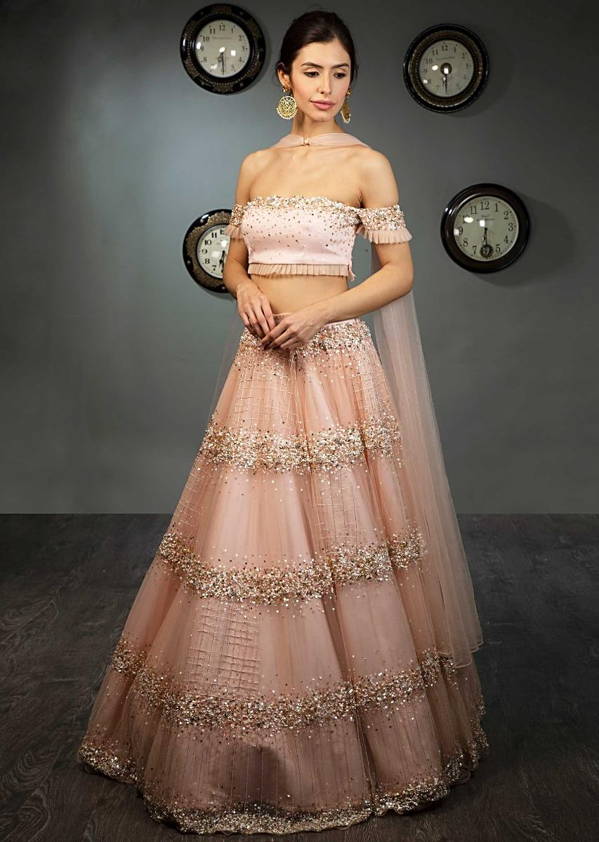 fdf57450e5 Peach off shoulder crop top paired with matching net skirt in moti and sequins  embroidery only on Kalki