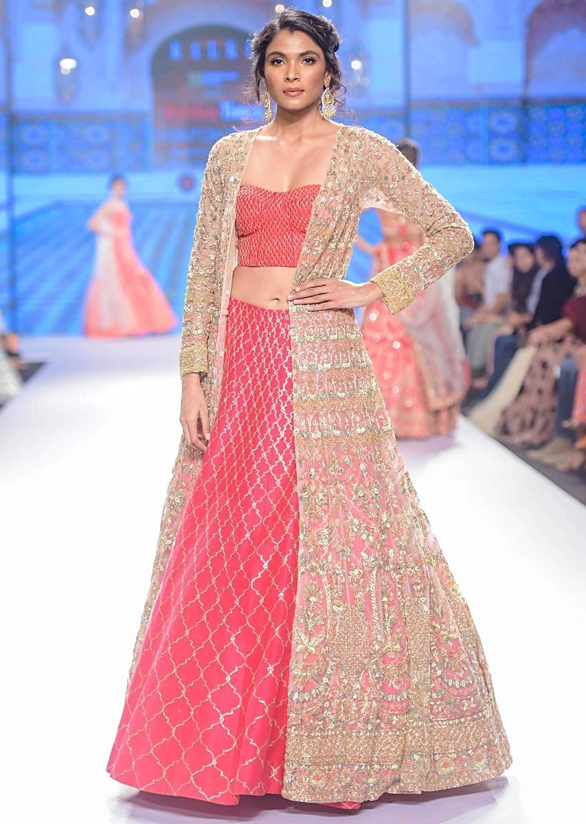 Buy Hot Pink Lehenga And Corset Paired With Heavy Embroidered Net ...