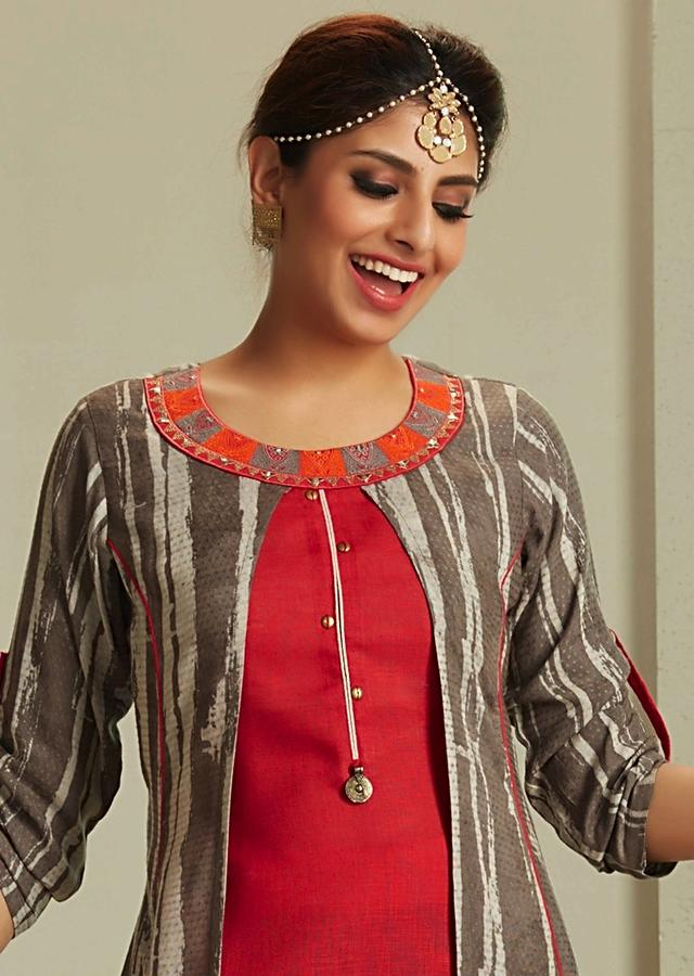 A line suit in red and grey top layer with resham embroidered neckline only on Kalki