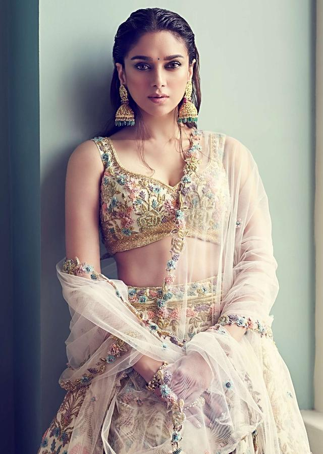 Aditi Rao Hydari in Kalki cream lehenga choli with embossed embroidery and net dupatta