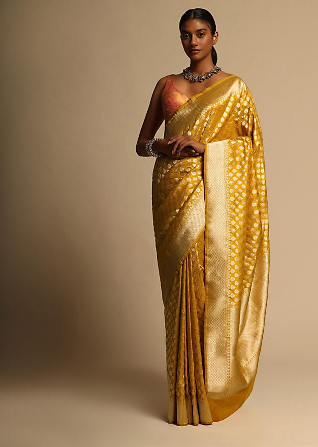 Amber Yellow Banarasi Saree In Pure Handloom Silk With Woven Floral Buttis And Chevron Border Along With Unstitched Blouse Piece Online - Kalki Fashion