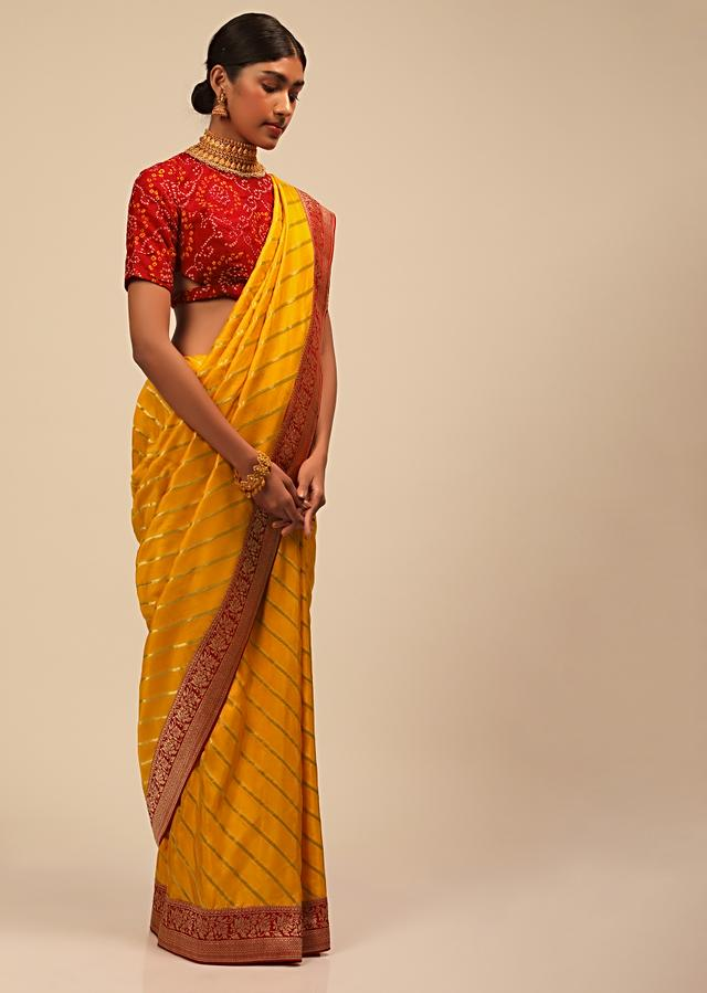 Amber Yellow In Silk With Diagonal Stripes And Red Brocade Bandhani Pallu And Border Along With Unstitched Blouse Online - Kalki Fashion