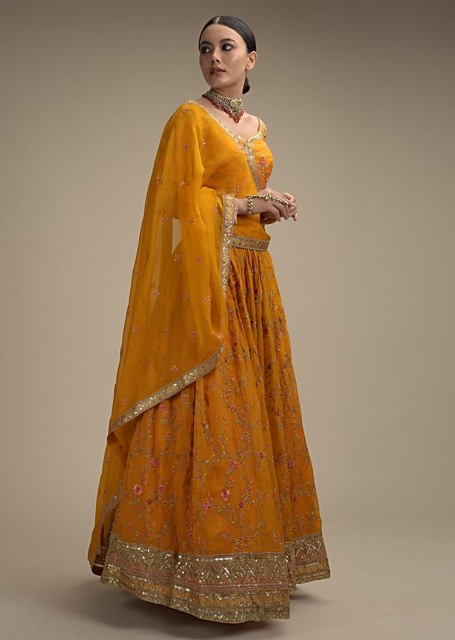 Amber Yellow Lehenga Choli In Organza With Colorful Resham Embroidered Floral Jaal And Sequins Border Online - Kalki Fashion