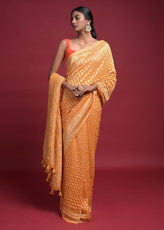 Amber Yellow Saree In Georgette With Weaved Buttis And Floral Pattern On The Border Online - Kalki Fashion