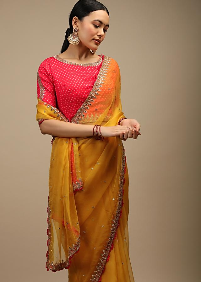Amber Yellow Saree In Organza With Mirror Work And A Coral Choli Adorned In Bandhani Print Online - Kalki Fashion