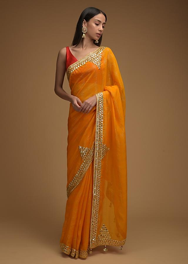 Amber Yellow Saree In Organza With Zari Woven Checks And Gotta Patti Work On The Border Along With Unstitched Blouse Online - Kalki Fashion