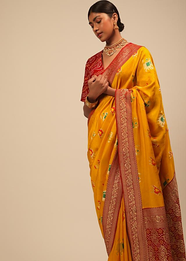 Amber Yellow Saree In Silk With Elephant And Bird Motifs And Red Brocade Bandhani Pallu And Border Along With Unstitched Blouse Online - Kalki Fashion