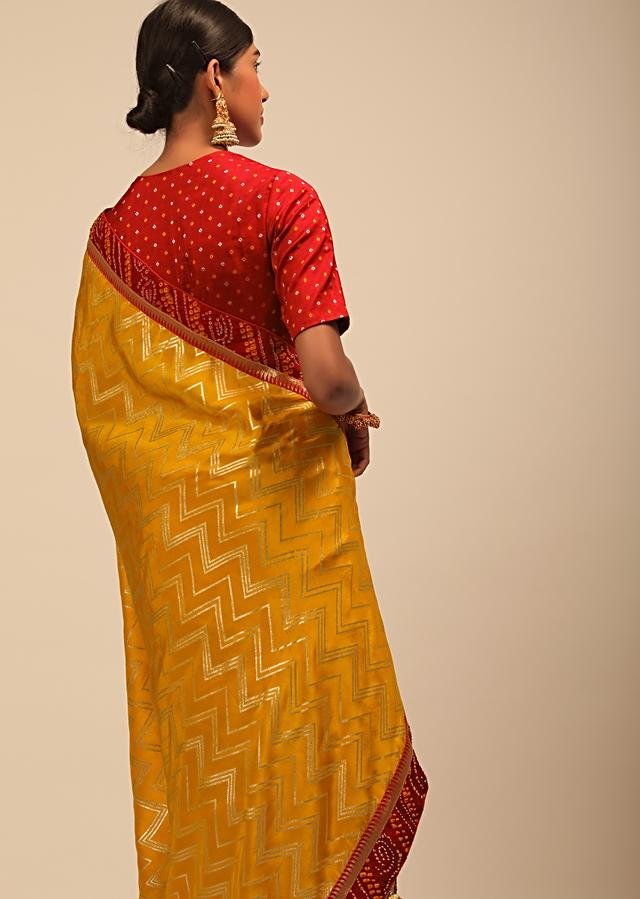 Amber Yellow Saree In Silk With Lurex Woven Chevron Design And Red Bandhani Border Along With Unstitched Blouse Online - Kalki Fashion