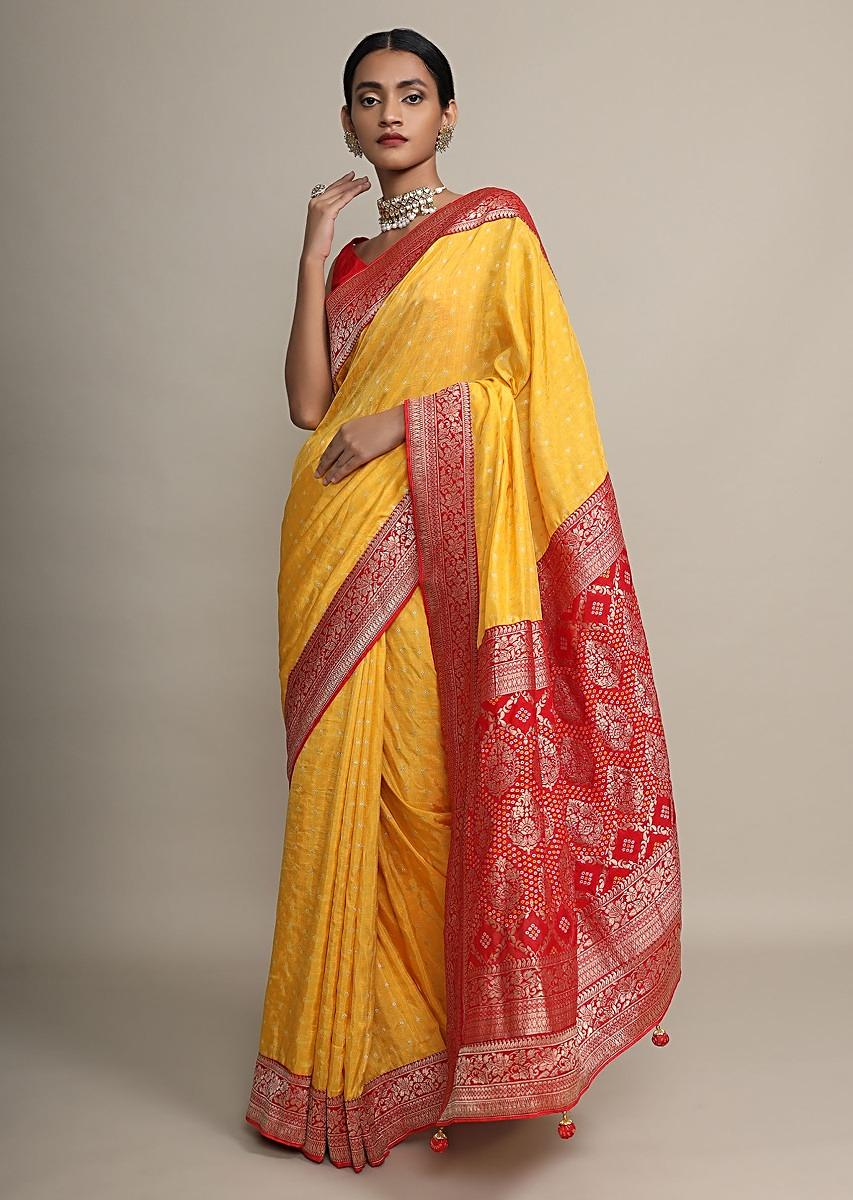 Amber Yellow Saree With Bandhani Print All Over And Red Border With Floral Weave Online - Kalki Fashion