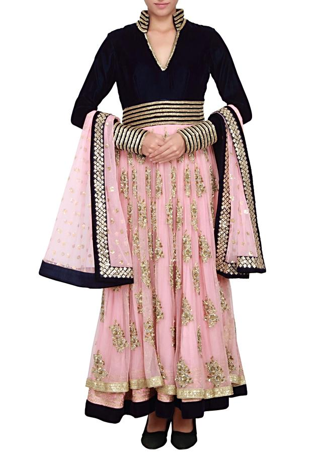 Anarkali in navy blue and peach in net and velvet embellished in zardosi and sequin only on Kalki