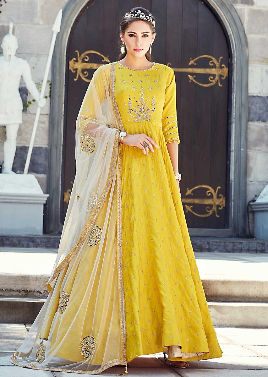 699d65459d50 Anarkali suit featuring in yellow silk embellished in mirror and zardosi  embroidery
