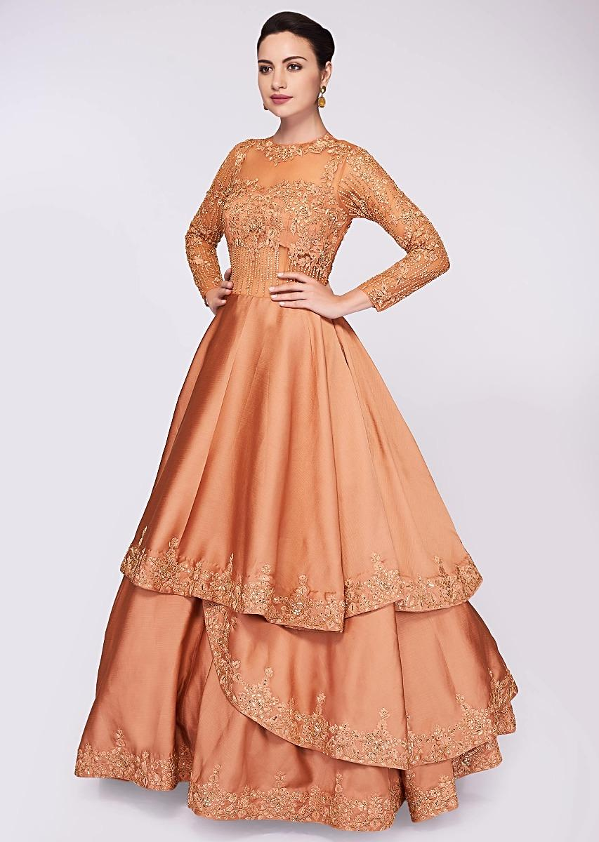 5aaa5a72439 Apricot brown ballroom gown with multiple layers in net and crepe only on  Kalki