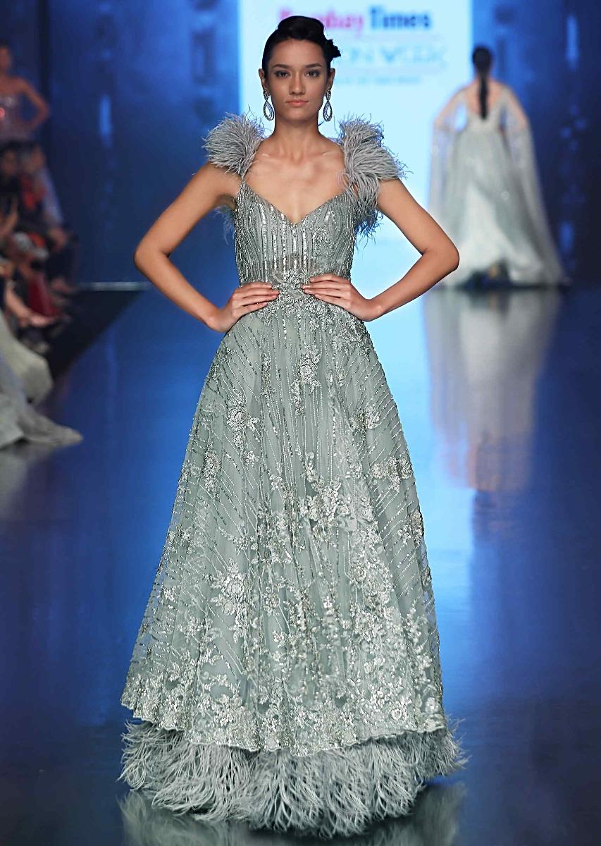d8217e35ebd Aqua blue embroidered net gown with feathers at the strap and hem only on  KalkiMore Detail