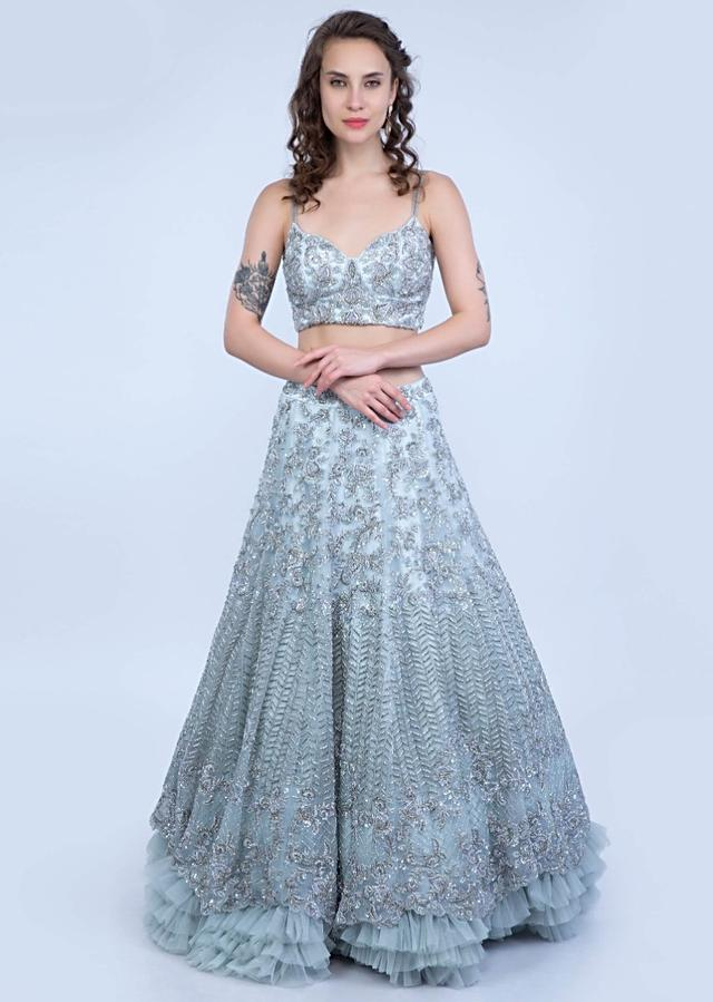 Aqua Blue Lehenga In Heavy Embroidered Net With Multi Layer Net Pleating At The Hem Online - Kalki Fashion