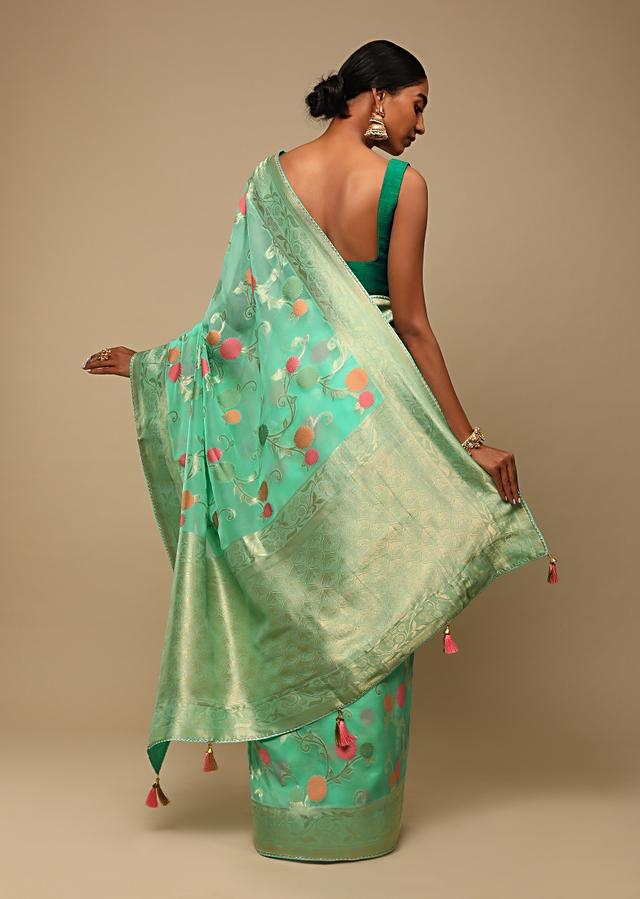 Aqua Saree In Organza With Multi Colored Woven Floral Jaal And Moroccan Motifs On The Pallu Along With Unstitched Blouse Online - Kalki Fashion