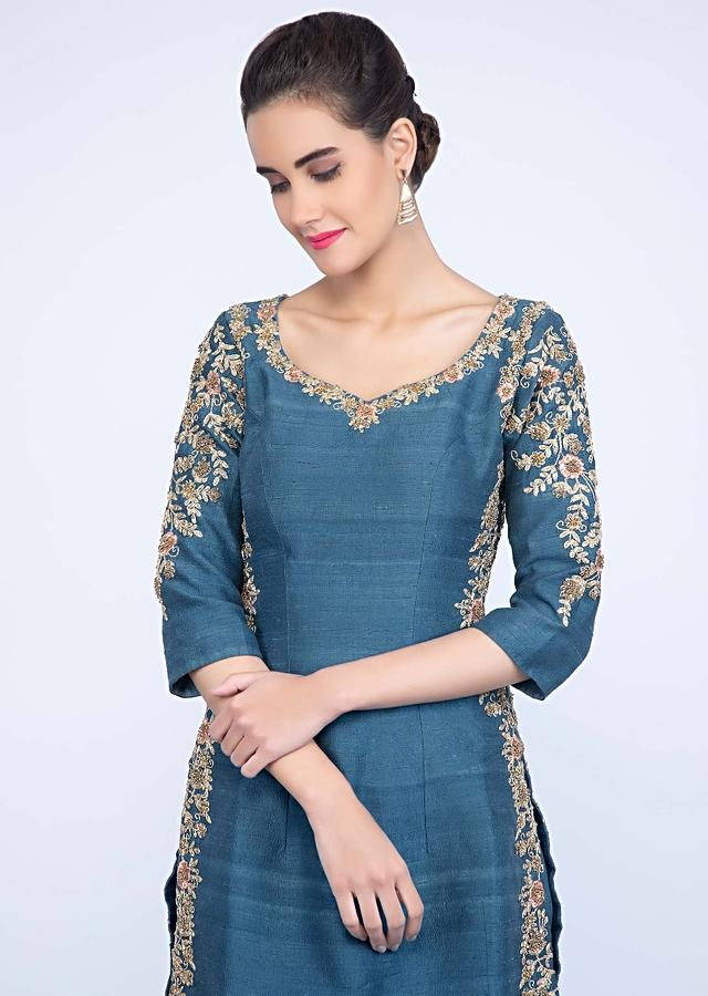 Azure blue embroidered suit with crushed georgette sharara and peach net dupatta only on kalki