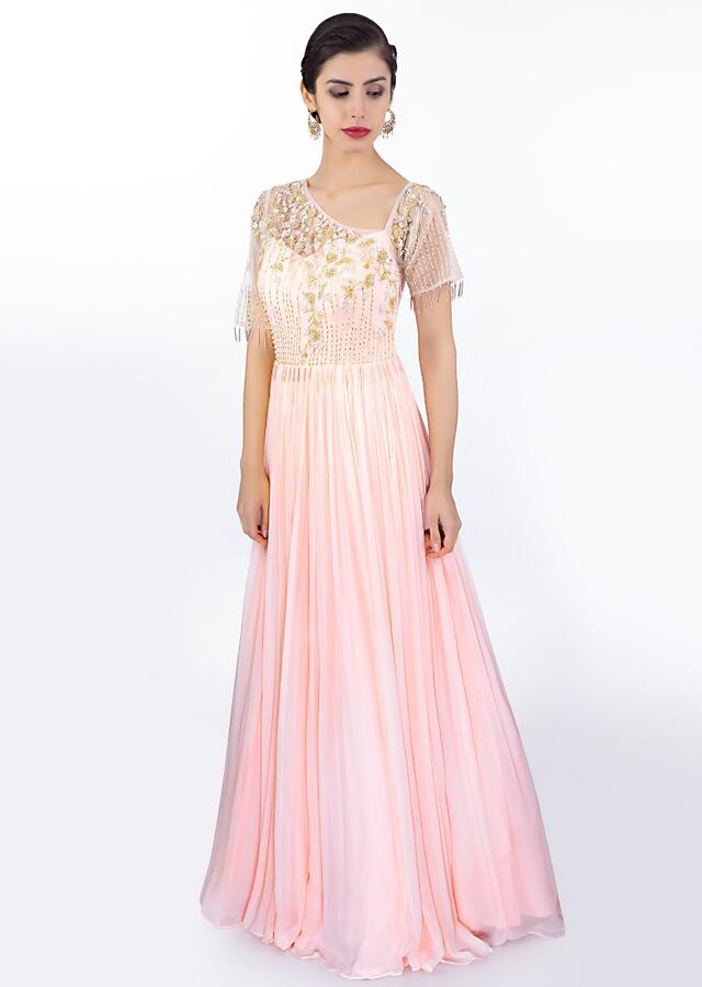Baby pink georgette gown in net bodice with floral embroidery only on Kalki