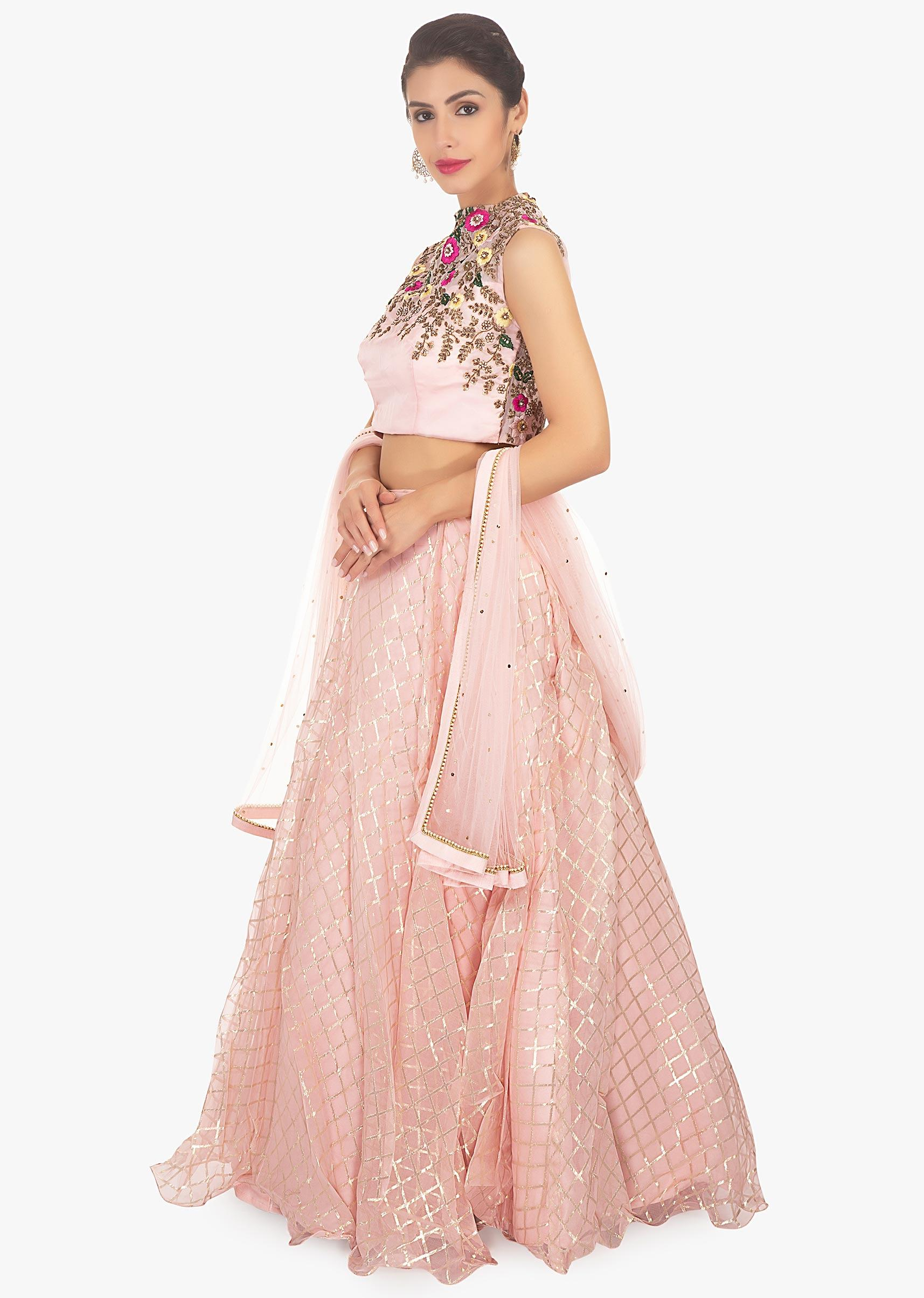 8392562f99 Cream net lehenga paired with sequin fabric blouse and matching net ...