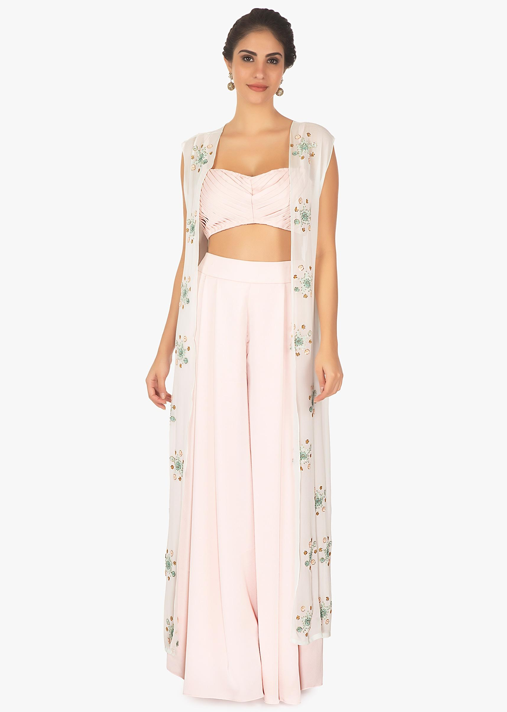 ddd3c6b1ef63f1 Baby pink palazzo pant and crop top paired with a blue overlay long jacket  only on Kalki