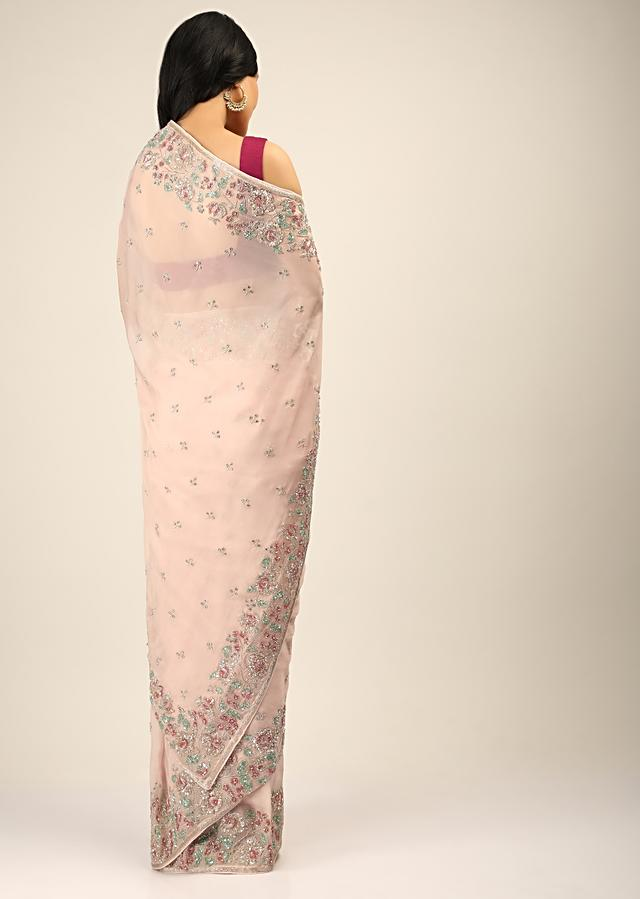 Baby Pink Saree In Organza With Multi Colored Sequins Embroidered Floral Motifs On The Border And Butti Work Online - Kalki Fashion