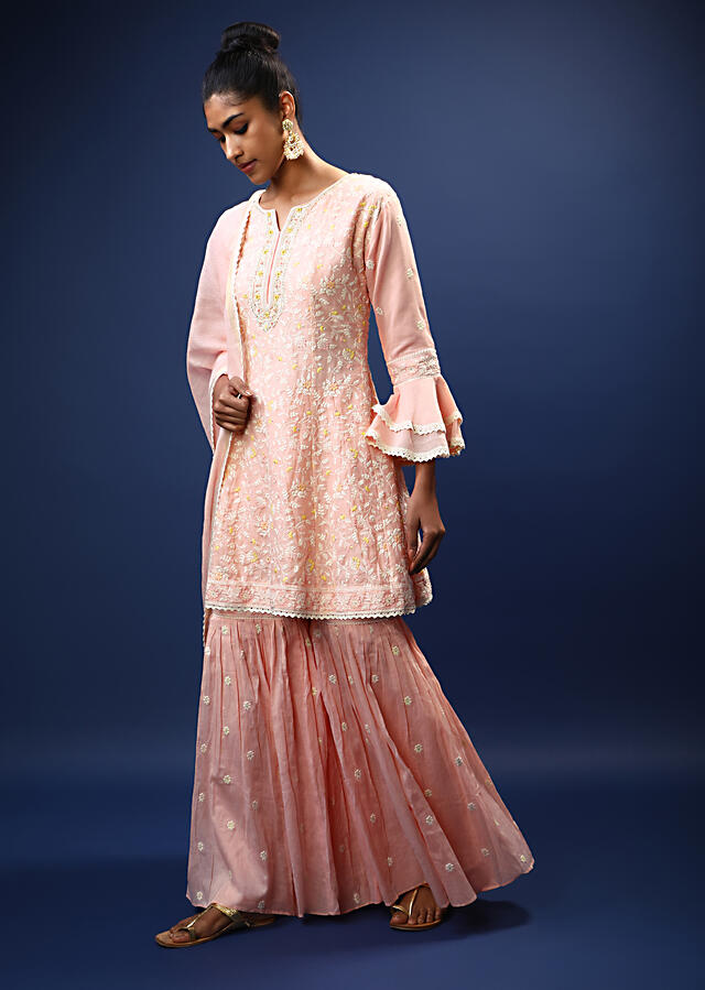 Baby Pink Sharara Peplum Suit In Cotton With Pastel And White Thread Embroidered Floral Motifs And Ruffle Sleeves Online - Kalki Fashion