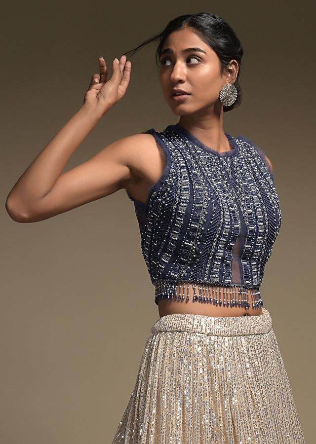 Beige And Blue Shaded Skirt In Net With Sequins Work And Embellished Sleeveless Crop Top Online - Kalki Fashion