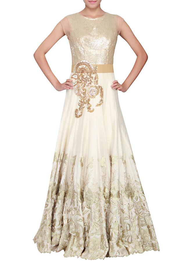 Beige and cream gown featured in net and raw silk embellished in zari and sequin only on Kalki
