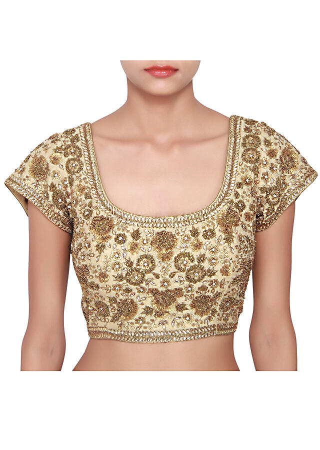 Beige blouse featured in raw silk, embellished in gold zardozi work over-all  only on Kalki