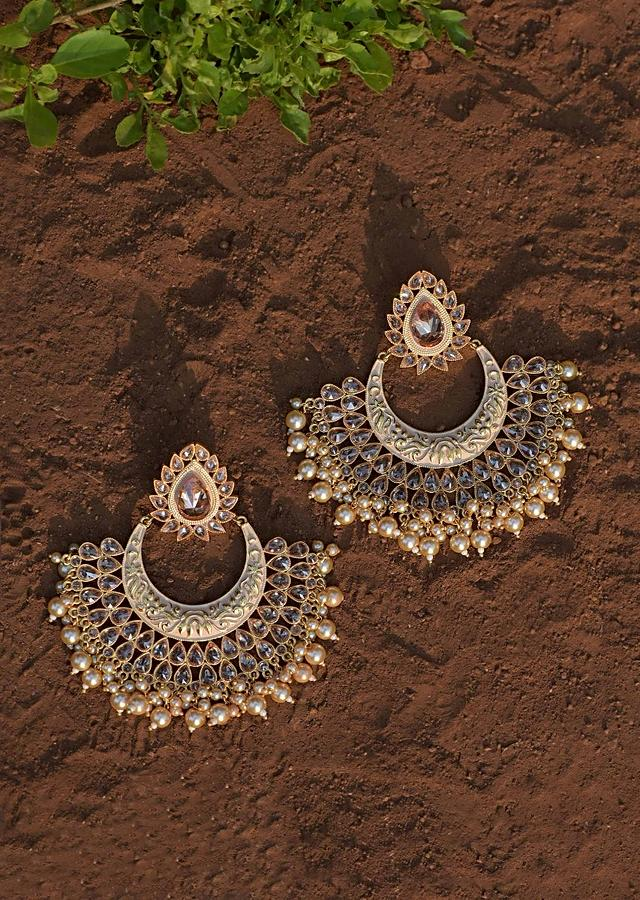 Beige Chandbalis With Carved Design, Drop Shape Crystals And Dangling Pearls Online - Kalki Fashion