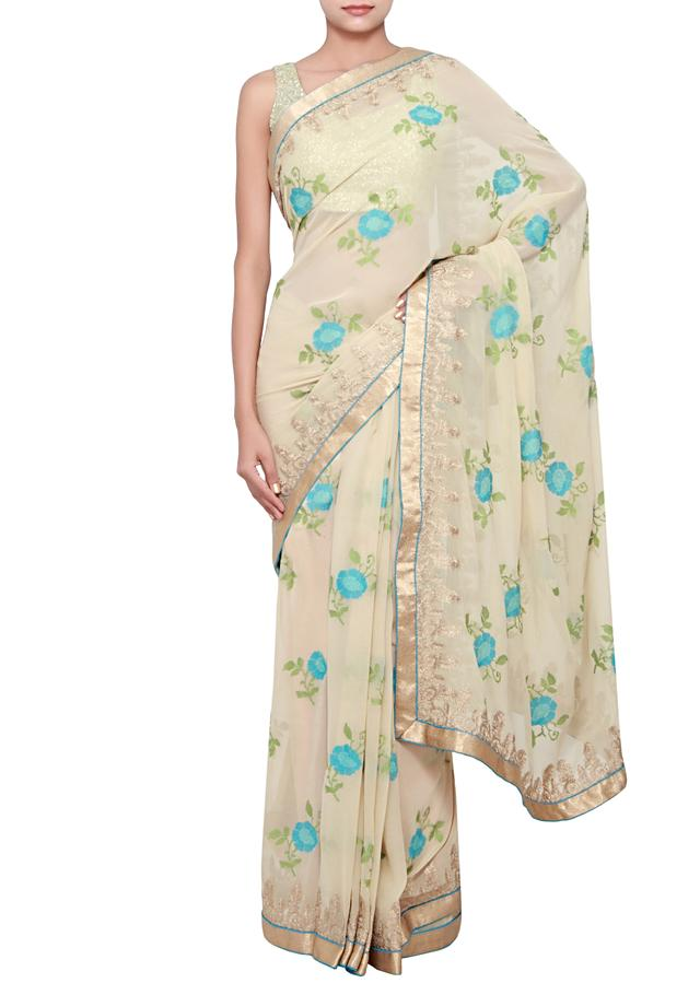 Undertoned beige georgette saree embellished in zari and thread embroidery only on Kalki