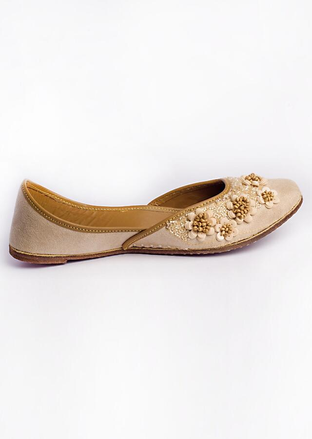 Beige Juttis In Suede Embroidered With Wooden And Acrylic Beads Along With Matte Sequins In Floral Motifs By Vareli Bafna