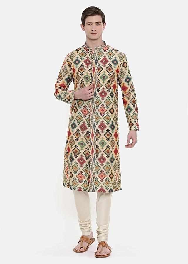 Beige Kurta And Churidar Set Adorned With All Over Print By Mayank Modi