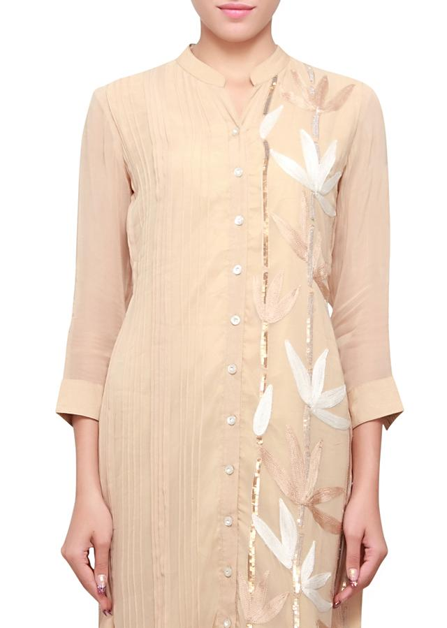 Beige kurti with embellished pleats and sequence only on kalki