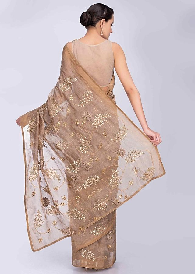 Beige Linen Saree With Gotta Jaal Embroidery And Floral Applique Work Online - Kalki Fashion