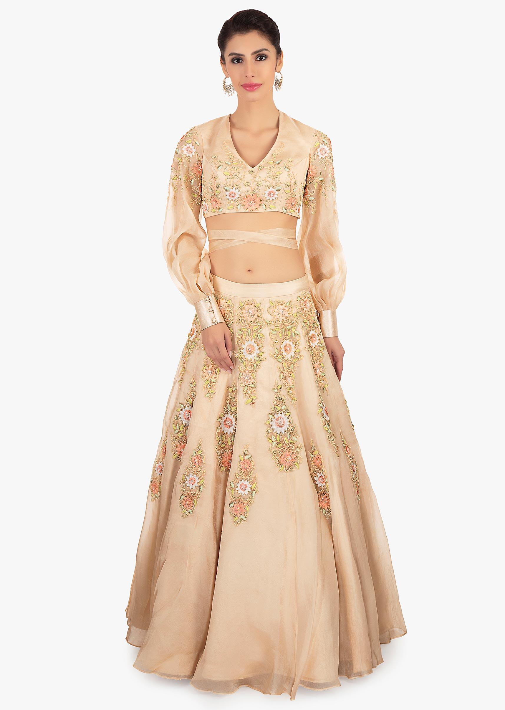 ff03c7f6f5156 Beige organza lehenga paired with a matching blouse in tie up strap from  the waist only ...