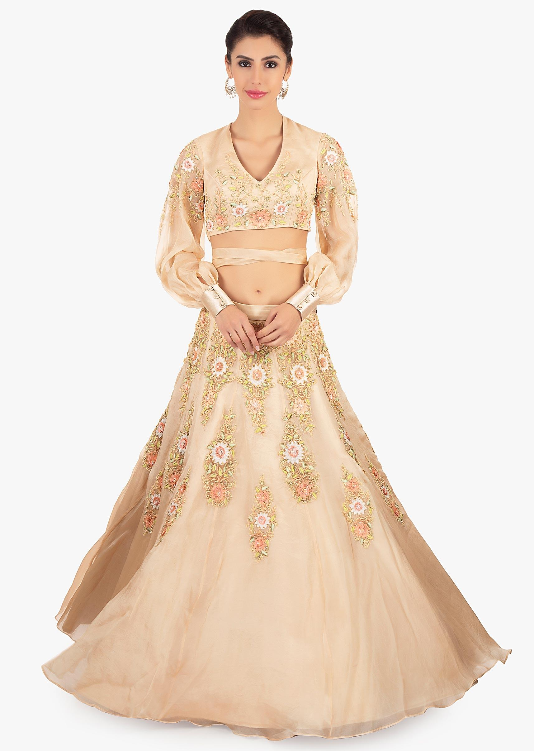 Beige organza lehenga paired with a matching blouse in tie up strap from  the waist only on KalkiMore Detail 0bb8cc558