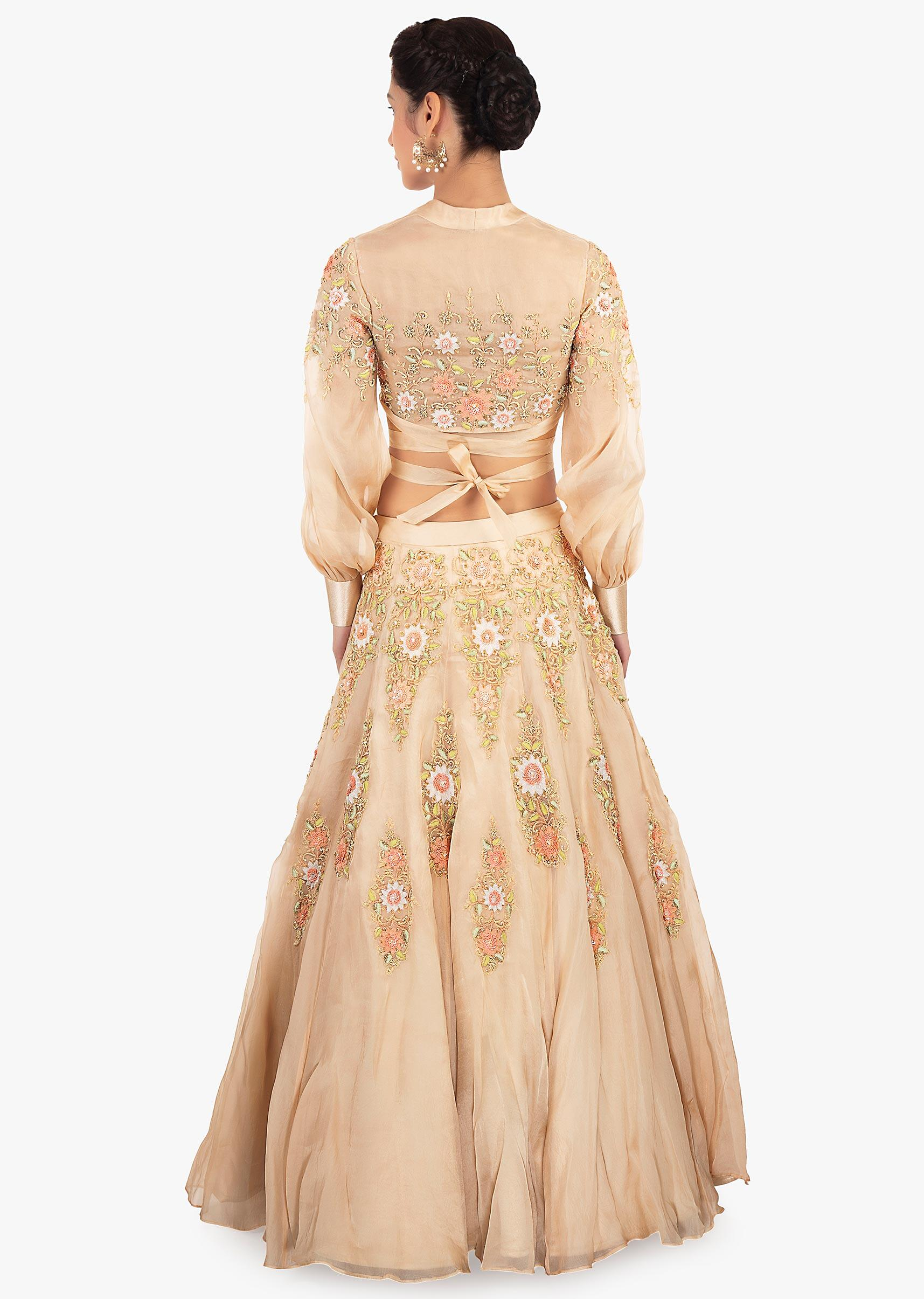 Beige organza lehenga paired with a matching blouse in tie up strap from  the waist only ... 3d49b3165