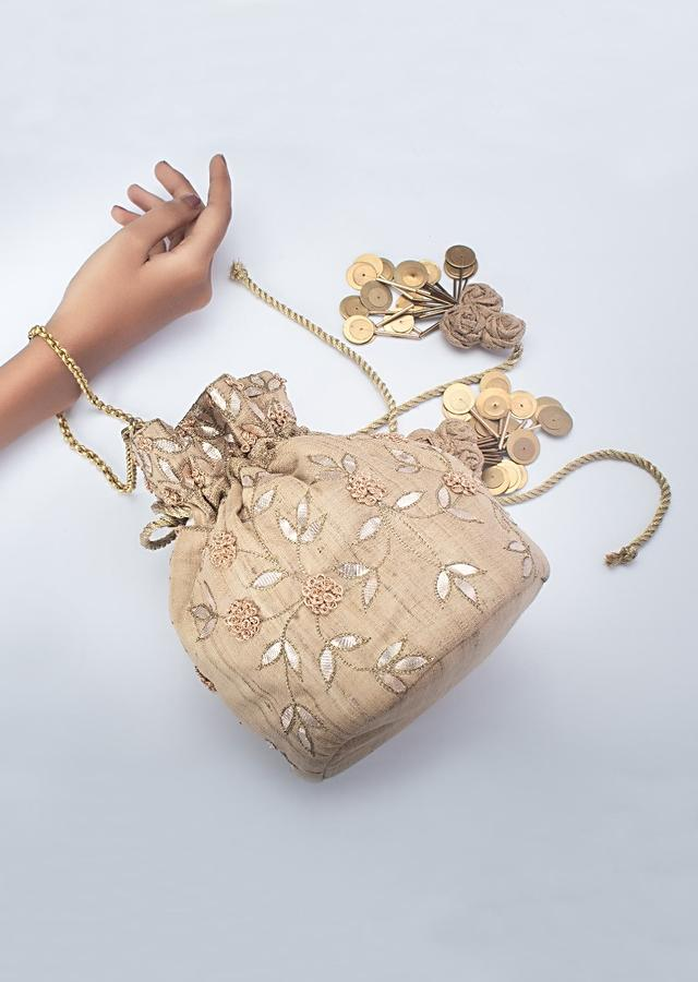 Beige Potli Adorned With Golden French Knot Flowers And Gotta Patti Work By Vareli Bafna
