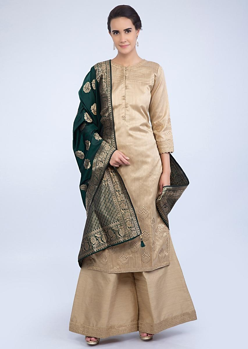 b44f850775 Beige raw silk suit and palazzo with contrasting emerald green banarasi  dupatta only on KalkiMore Detail