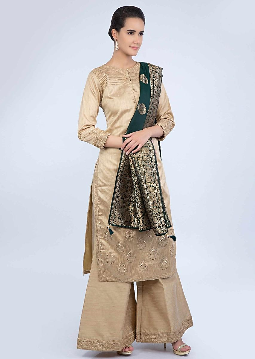 0e1efec30a Beige raw silk suit and palazzo with contrasting emerald green banarasi  dupatta only on Kalki