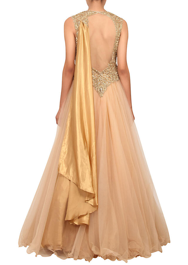 Beige saree gown featured in net with gold sequin work on the bodice only on Kalki