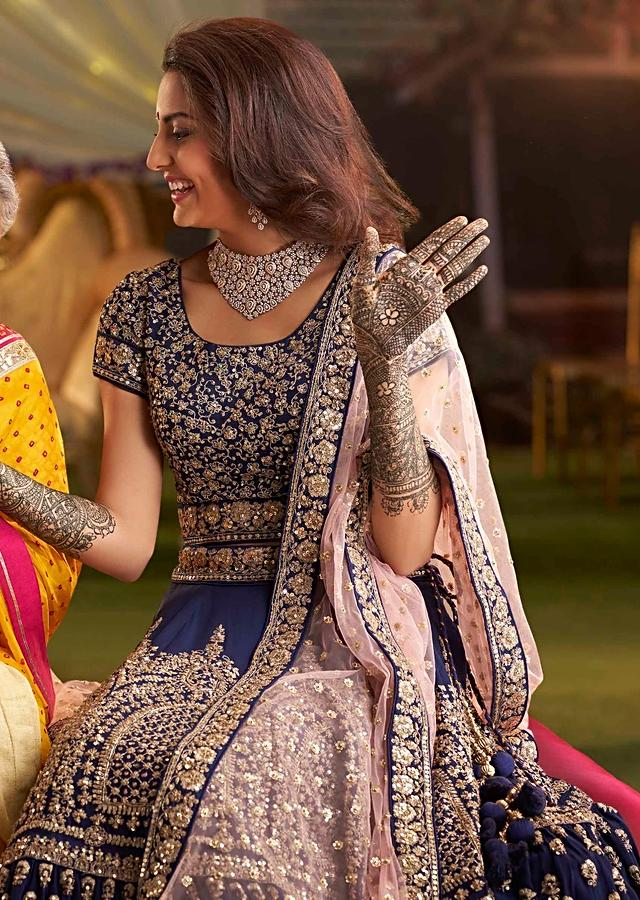 Berry Blue Lehenga With Heavy Zardosi Embroidery And Blouse With Contrasting Pink Net Dupatta Online - Kalki Fashion