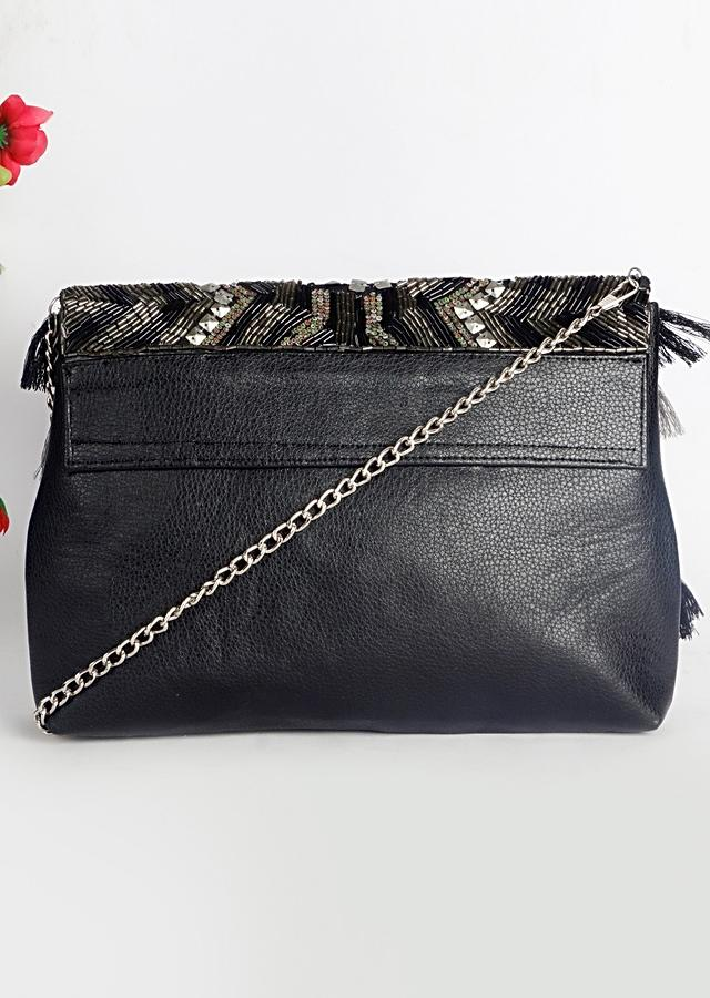 Black Faux Leather Bag With Metal Sequins Work And Tassels By Sole House