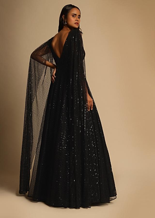 Black Gown In Sequins Embellished Net With Ruching In The Front, Sheer Sides And Net Cape On Each Shoulder Online - Kalki Fashion