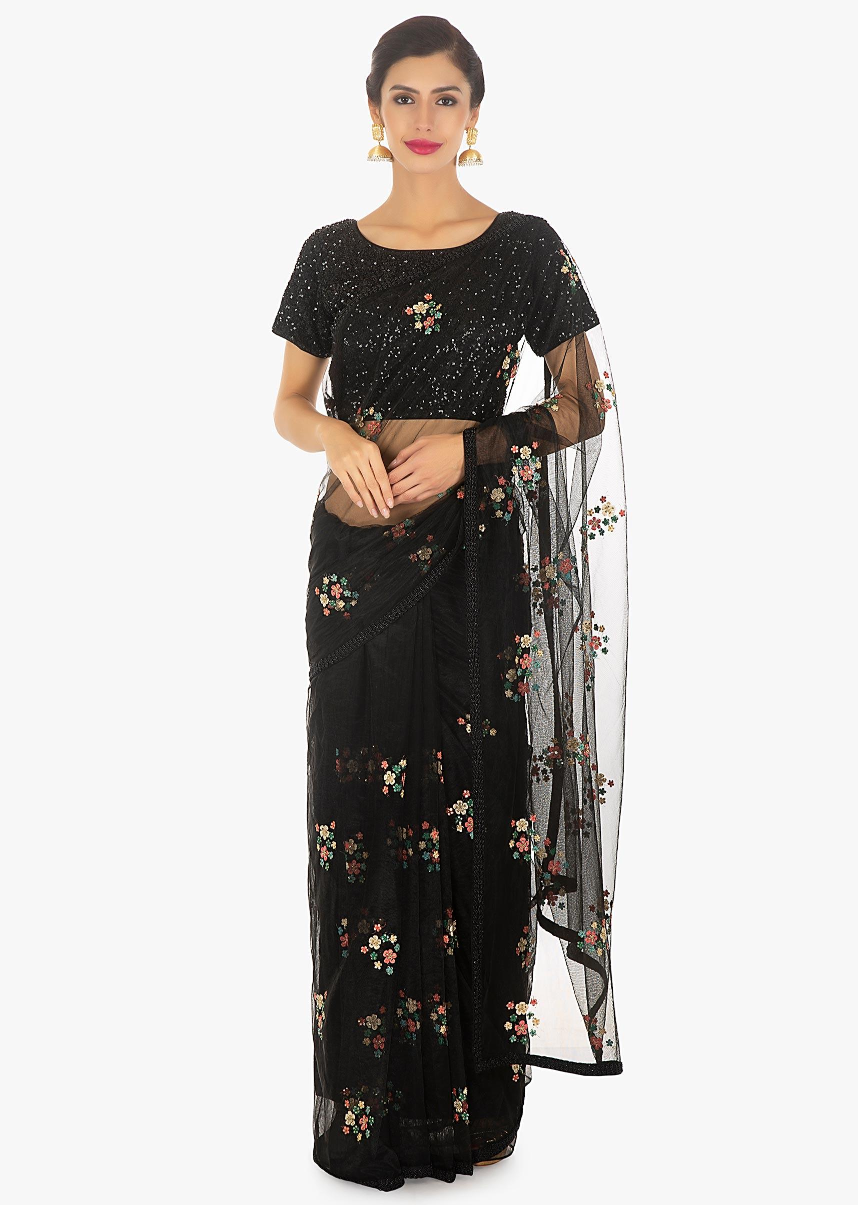 98d7e24103cbc4 Black net thread embroidered saree paired with a shimmery sequins blouse  only on Kalki